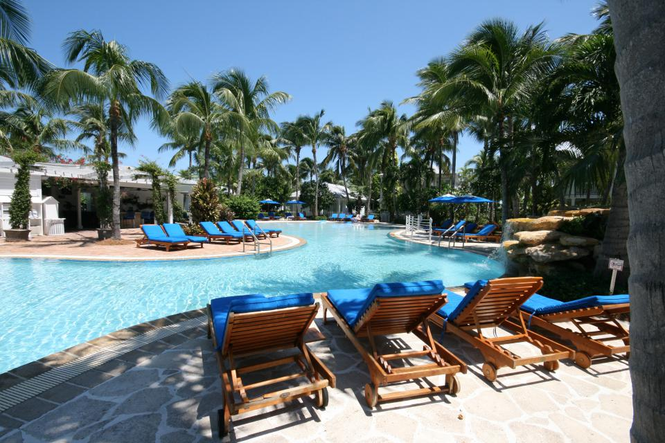 Commercial sunset key florida keys island hotel resort tropical deck level lagoon pool spa